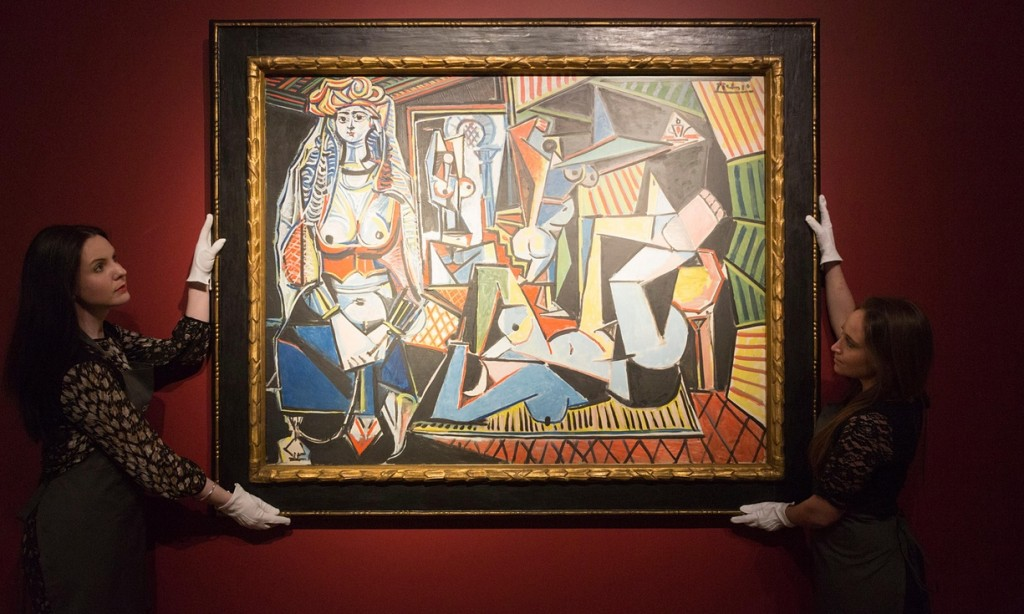 Christie's employees handle Les femmes d'Alger by Pablo Picasso, which sold last year for $179.4m. Photograph: ukartpics / Alamy/Alamy