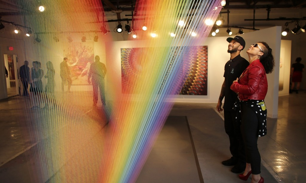 Musician Alicia Keys, right, and her husband Swizz Beatz look at an installation by artist Gabriel Dawe, in Miami. Photograph: Lynne Sladky/AP